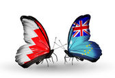 Butterflies with Bahrain and Tuvalu flags on wings — Stock Photo