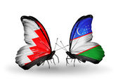Butterflies with Bahrain and Uzbekistan flags on wings — Stock Photo
