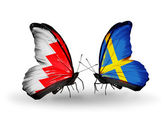 Butterflies with Bahrain and Sweden flags on wings — Stock Photo