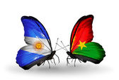 Butterflies with Argentina and Burkina Faso flags on wings — Stock Photo