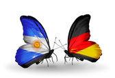 Fjärilar med argentina och tyskland flaggor på vingar — Stockfoto