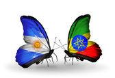 Motýli s argentinou a etiopie vlajky na křídlech — Stock fotografie