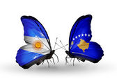 Butterflies with Argentina and Kosovo flags on wings — Stock Photo