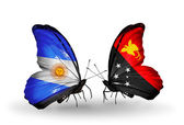 Butterflies with Argentina and Papua New Guinea flags on wings — Stock Photo