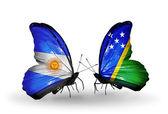 Farfalle con bandiere argentina e isole salomone sulle ali — Foto Stock