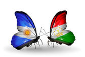 Butterflies with Argentina and Tajikistan flags on wings — Stock Photo