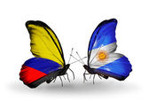 Butterflies with Columbia and Argentina flags on wings — Stock Photo