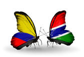 Butterflies with Columbia and Gambia flags on wings — Stock Photo