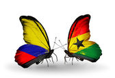 Butterflies with Columbia and Ghana flags on wings — Stock Photo