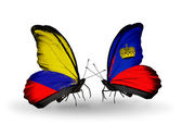 Butterflies with Columbia and Liechtenstein flags on wings — Stock Photo