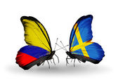 Butterflies with Columbia and Sweden flags on wings — Stock Photo