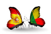 Butterflies with Spain and Benin flags on wings — Stock Photo