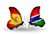 Butterflies with Spain and Gambia flags on wings — Stock Photo