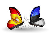 Butterflies with Spain and Estonia flags on wings — Stock Photo