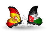 Butterflies with Spain and Jordan flags on wings — Stock Photo