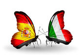 Butterflies with Spain and Italy flags on wings — Stock Photo