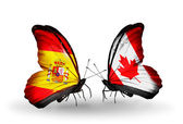 Butterflies with Spain and Canada flags on wings — Stock Photo
