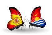 Butterflies with Spain and Kiribati flags on wings — Stock Photo