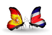 Butterflies with Spain and Costa Rica flags on wings — Stock Photo