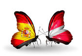 Butterflies with Spain and Latvia flags on wings — Stock Photo