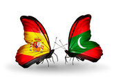 Butterflies with Spain and Maldives flags on wings — 图库照片