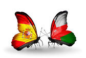 Butterflies with Spain and Oman flags on wings — Foto Stock