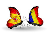 Butterflies with Spain and Chad, Romania flags on wings — Stock Photo