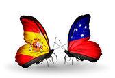 Mariposas con banderas de España y samoa en alas — Foto de Stock