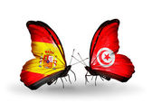 Butterflies with Spain and Tunisia flags on wings — Stock Photo