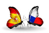 Butterflies with Spain and Czech flags on wings — Stock Photo