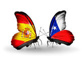 Butterflies with Spain and Chile flags on wings — Stock Photo