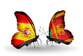 Butterflies with Spain and Sri Lanka flags on wings — Stock Photo
