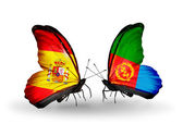 Butterflies with Spain and Eritrea flags on wings — Stock Photo