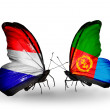 Stock Photo: Butterflies with Holland and Eritreflags on wings