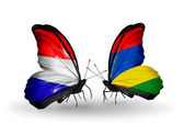 Butterflies with Holland and Mauritius flags on wings — Stock Photo