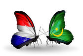 Butterflies with Holland and Mauritania flags on wings — Stock Photo