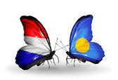 Butterflies with Holland and Palau flags on wings — Stock Photo