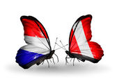 Butterflies with Holland and Peru flags on wings — Stock Photo