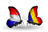 Butterflies with Holland and Chad, Romania flags on wings — Stock Photo