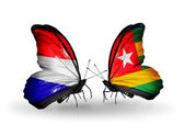 Butterflies with Holland and Togo flags on wings — Stock Photo