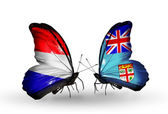 Butterflies with Holland and Fiji  flags on wings — Stock Photo