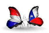 Butterflies with Holland and Chile flags on wings — Stock Photo