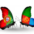 Stock Photo: Butterflies with Portugal and Eritreflags on wings