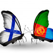 Stock Photo: Butterflies with Finland and Eritreflags on wings