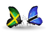 Vlinders met jamaica en botswana vlaggen op vleugels — Stockfoto