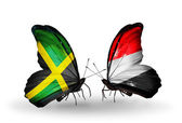 Butterflies with Jamaica and Yemen flags on wings — Stock Photo