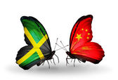 Butterflies with Jamaica and China flags on wings — Stock Photo