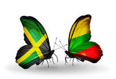 Butterflies with Jamaica and Lithuania flags on wings — Stock Photo