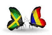 Papillons avec la jamaïque et le tchad, les drapeaux de la roumanie sur les ailes — Photo