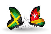Butterflies with Jamaica and Togo flags on wings — Stock Photo
